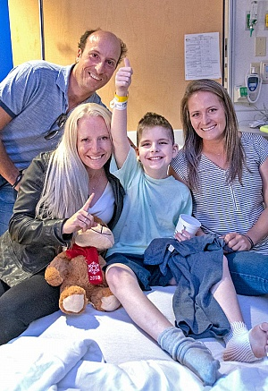 Tim Price (NZL) Hannah Sue Burnett (USA) and Hawley Bennett-Awad (CAN) visit with Gabriel Crum-Esteppe, 9, of Jeffersonville, KY during a visit to Kentucky Children's Hospital.